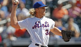 New York Mets starting pitcher Noah Syndergaard (34) winds up during the first inning of a baseball game against the Philadelphia Phillies, Sunday, Sept. 8, 2019, in New York. (AP Photo/Kathy Willens)