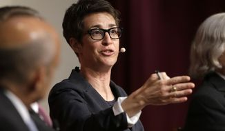 "FILE - In this Oct. 16, 2017, file photo, MSNBC television anchor Rachel Maddow, host of the Rachel Maddow Show, moderates a panel at a forum called ""Perspectives on National Security"" at the John F. Kennedy School of Government on the campus of Harvard University in Cambridge, Mass. A conservative television network is suing Rachel Maddow for calling it ""paid Russian propaganda."" One America News seeks $10 million in a federal suit filed Monday, Sept. 9, 2019, in San Diego. (AP Photo/Steven Senne, File)"