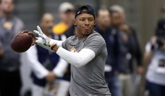 FILE - In this March 31, 2017, file photo, quarterback Josh Dobbs throws to a receiver during Tennessee NFL Pro Day in Knoxville, Tenn. The Jacksonville Jaguars have acquired quarterback Josh Dobbs in a trade with Pittsburgh, giving them a backup while Nick Foles recovers from a broken collarbone. The Jaguars gave up a fifth-round pick in the 2020 draft for Dobbs, who was in his third season with the Steelers. He was a fourth-round pick in 2017. (AP Photo/Wade Payne, File)