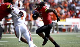 Maryland running back Anthony McFarland Jr. (5) runs the ball for a touchdown during the first half of an NCAA college football game against Syracuse, Saturday, Sept. 7, 2019, in College Park, Md. (AP Photo/Will Newton)