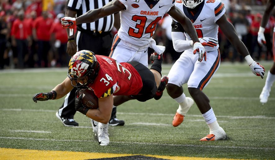 Maryland running back Jake Funk (34) dives for a touchdown in front of Syracuse defensive back Eric Coley (34) during the second half of an NCAA college football game, Saturday, Sept. 7, 2019, in College Park, Md. (AP Photo/Will Newton) ** FILE **