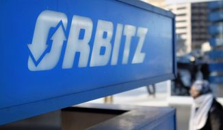 FILE - This Feb. 12, 2015 file photo shows signage for travel booking site Orbitz outside the building that houses its headquarters, in Chicago. The Arizona Supreme Court on Monday, Sept. 9, 2019, ruled Orbitz and other online travel companies must pay sales taxes to cities for their work in arranging hotel stays for customers, but it remains unclear whether the communities will be able to collect millions of dollars in back taxes. (AP Photo/Kiichiro Sato, File)