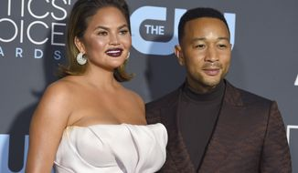Chrissy Teigen, left, and John Legend arrive at the 24th annual Critics' Choice Awards at the Barker Hangar in Santa Monica, California, Jan. 13, 2019. (Photo by Jordan Strauss/Invision/AP) ** FILE **