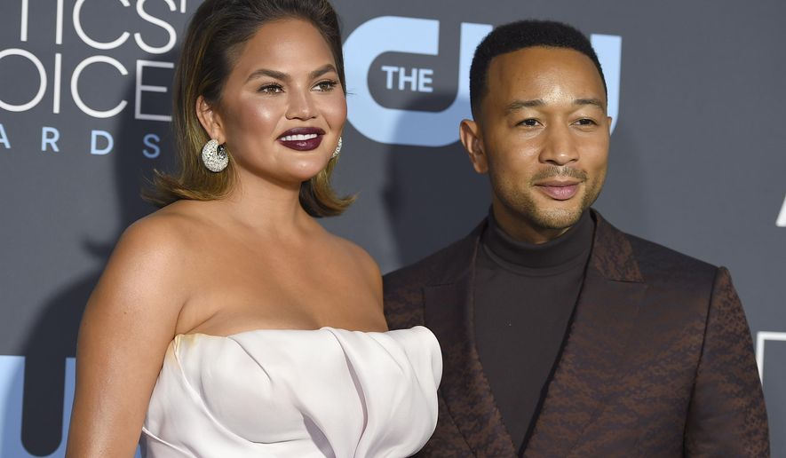 In this Jan. 13, 2019 file photo, Chrissy Teigen, left, and John Legend arrive at the 24th annual Critics' Choice Awards at the Barker Hangar in Santa Monica, Calif. (Photo by Jordan Strauss/Invision/AP, File)