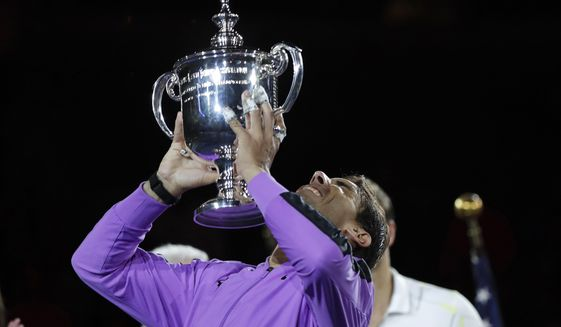Rafael Nadal, of Spain, holds up the trophy after defeating Daniil Medvedev, of Russia, to win the men's singles final of the U.S. Open tennis championships Sunday, Sept. 8, 2019, in New York. (AP Photo/Adam Hunger) ** FILE **
