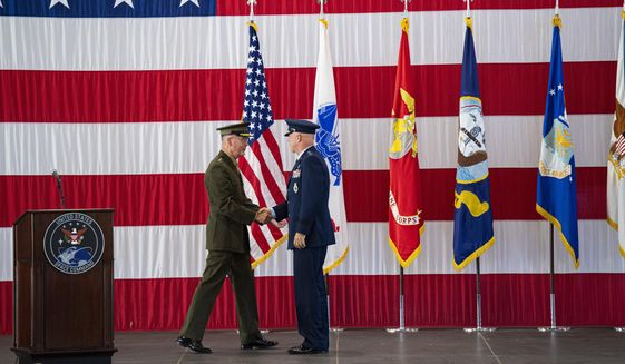 Then-Joint Chiefs of Staff Gen. Joseph F. Dunford Jr., left, shakes hands with Gen. John W. Raymond, the commander of the U.S. Space Command, Sept. 9, 2019, during a ceremony to recognize the establishment of the United States Space Command at Peterson Air Force Base in Colorado Springs, Colo.  (Christian Murdock/The Gazette via AP) ** FILE **