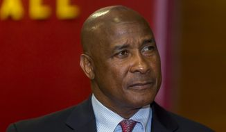 FILE - In this April 14, 2016, file photo, University of Southern California's new athletic director Lynn Swann pauses during his appointment news conference at the USC campus in Los Angeles. Southern California athletic director Swann has resigned.USC President Carol L. Folt announced the decision in a letter Monday, Sept. 9, 2019. (AP Photo/Damian Dovarganes, File)