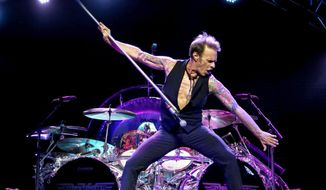 FILE - This Sept. 28, 2015 file photo shows David Lee Roth performing at Ak-Chin Pavillion in Phoenix, Ariz.  Roth, the high-kicking lead singer of the rock band Van Halen, will have a mini-residence at the House of Blues Las Vegas in the Mandalay Bay Resort and Casino. He'll be performing Jan. 8, Jan. 10-11 and March 18, March 20-21, March 25, and March 27-28. Tickets go on sale Saturday.(Photo by Rick Scuteri/Invision/AP, File)