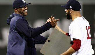 Boston Red Sox's David Price (10) greets New York Yankees' CC Sabathia during a ceremony to honor Sabathia before a baseball game in Boston, Sunday, Sept. 8, 2019. (AP Photo/Michael Dwyer)