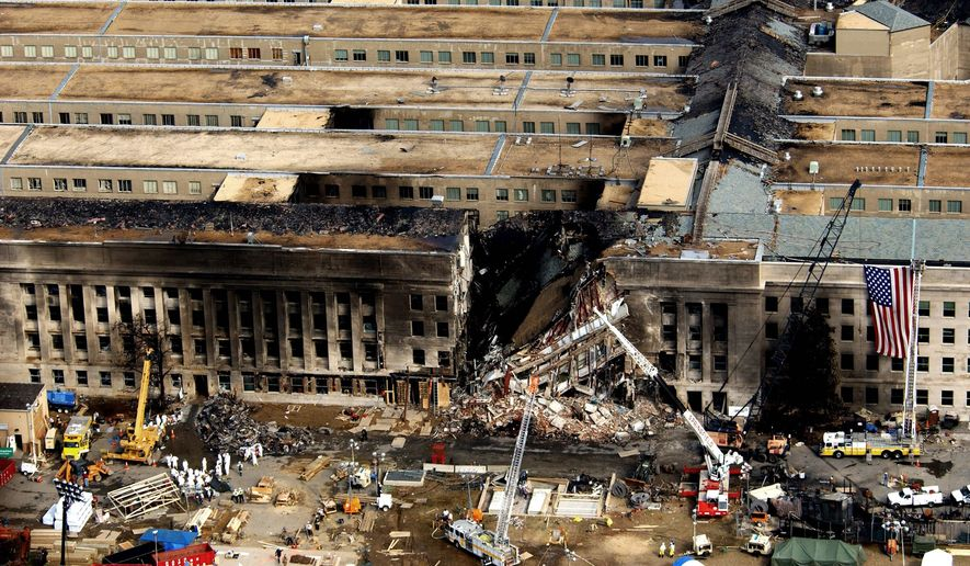 Aerial view of the Pentagon Building located in Washington, District of Columbia (DC), showing emergency crews responding to the destruction caused when a high-jacked commercial jetliner crashed into the southwest corner of the building, during the 9/11 terrorists attacks.