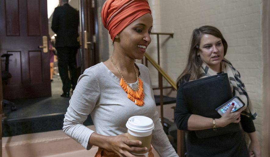 Rep. Ilhan Omar, D-Minn., departs a meeting of the House Democratic Caucus as Congress returns for the fall session with pressure mounting for a response to gun violence, at the Capitol in Washington, Tuesday, Sept. 10, 2019. Congressional Democrats are pressing President Donald Trump to intervene with Senate Republicans and demand passage of a bipartisan bill to expand background checks for gun purchases. (AP Photo/J. Scott Applewhite)