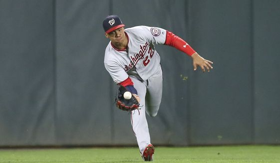 Washington Nationals left fielder Juan Soto catches a ball off the bat of Minnesota Twins' Jorge Polanco in the sixth inning of a baseball game Tuesday, Sept. 10, 2019, in Minneapolis. (AP Photo/Jim Mone)