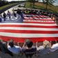 Visitors to the Flight 93 National Memorial in Shanksville, Pa., participate in a sunset memorial service on Monday, Sept. 10, 2019, as the nation prepares to mark the 18th anniversary of the Sept. 11, 2001 attacks. (AP Photo/Gene J. Puskar)
