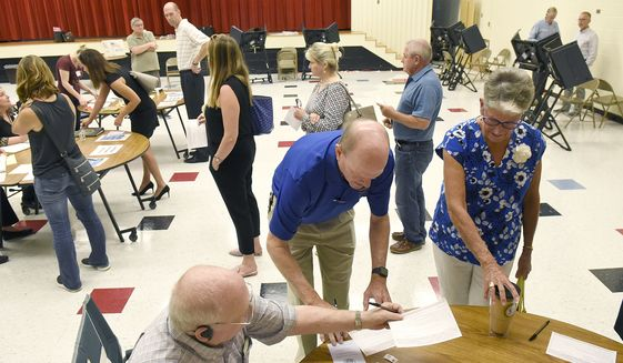 Precinct #74, at Alexander Graham Middle School, experienced a flurry of voters Tuesday, Sept. 10, 2019, as they cast their ballots in the party primaries and in the 9th District race between Dan Bishop and Dan McCready. (John D. Simmons/The Charlotte Observer via AP)