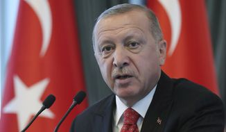 """Turkey's President Recep Tayyip Erdogan speaks to a group of US businessmen at his palace, in Ankara, Turkey, Tuesday, Sept. 10, 2019. Turkey accused the United States on Tuesday of taking only """"cosmetic steps"""" toward the creation of a so-called """"safe zone"""" in northeast Syria and renewed Ankara's threat of unilateral military intervention to form a buffer area along its border.(Presidential Press Service via AP, Pool)"""