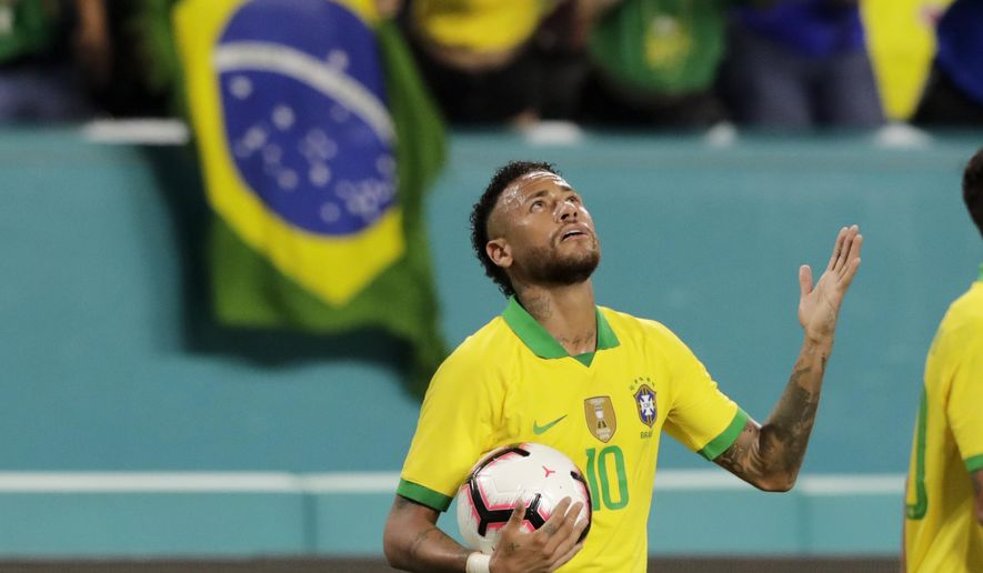 Brazil forward Neymar reacts after scoring a goal during the second half of a friendly soccer match against Colombia, Friday, Sept. 6, 2019, in Miami Gardens, Fla. (AP Photo/Lynne Sladky)
