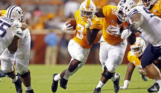 Tennessee running back Eric Gray (3) breaks free as he runs for yardage in the first half of an NCAA college football game against Brigham Young Saturday, Sept. 7, 2019, in Knoxville, Tenn. (AP Photo/Wade Payne)
