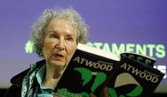 "Canadian author Margaret Atwood speaks during a press conference at the British Library to launch her new book ""The Testaments"" in London, Tuesday, Sept. 10, 2019. (AP Photo/Alastair Grant)"