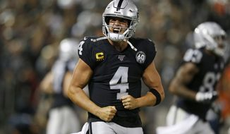 Oakland Raiders quarterback Derek Carr reacts after running back Josh Jacobs scored a touchdown during the fourth quarter of an NFL football game against the Denver Broncos Monday, Sept. 9, 2019, in Oakland, Calif. (AP Photo/D. Ross Cameron)