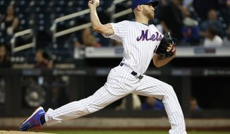New York Mets starting pitcher Zack Wheeler winds up during the first inning of the team's baseball game against the Arizona Diamondbacks, Tuesday, Sept. 10, 2019, in New York. (AP Photo/Kathy Willens)