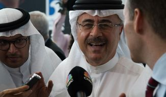 """Amin Nasser, the chairman and CEO of the state-run oil giant Saudi Aramco, speaks to journalists at the World Energy Congress in Abu Dhabi, United Arab Emirates, Tuesday, Sept. 10, 2019. Nasser told journalists Tuesday a planned initial public offering of a sliver of the oil company's worth would happen """"very soon."""" (AP Photo/Jon Gambrell)"""