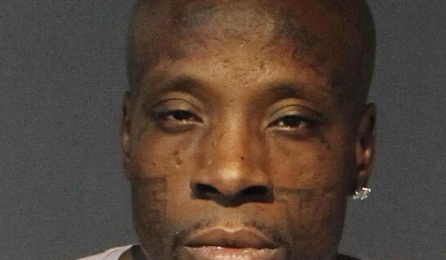 Terry Williams, a member of the Compton Crips in Los Angeles, is pictured in this booking photo taken Tuesday, Sept. 10, 2019 at the Washoe County Jail in Reno, Nevada after he was arrested on a fugitive warrant following a standoff with a SWAT team in neighboring Sparks. Federal agents had been looking for him since May when he walked away from a halfway house in Las Vegas. (AP Photo/Washoe County Sheriff's Office)