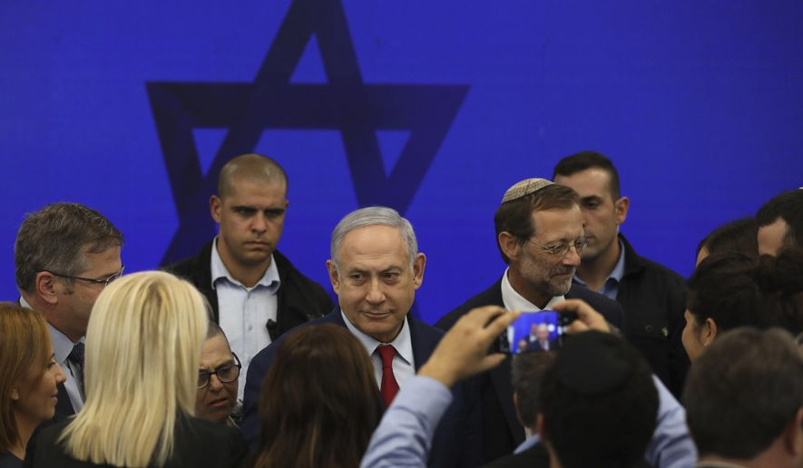 Israeli Prime Minister Benjamin Netanyahu leaves following a press conference in Tel Aviv, Israel, Tuesday, Sept. 10, 2019. Netanyahu vowed Tuesday to begin annexing West Bank settlements if he wins national elections next week. (AP Photo/Oded Balilty)