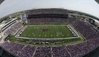 FILE - This Sept 7, 2019, file photo shows fans filling Bill Snyder Family Stadium during the first half of an NCAA college football game between Kansas State and Bowling Green in Manhattan, Kan. _ In the midst of another rout to begin Chris Klieman's tenure as the Kansas State coach, athletic director Gene Taylor announced more than $100 million in renovations to the football stadium and other facilities. In other words: It's a good time to be K-State. (AP Photo/Charlie Riedel, File)