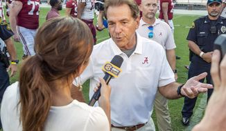 Alabama head coach Nick Saban talks with ESPN after a win over New Mexico State in an NCAA college football game Saturday, Sept. 7, 2019, in Tuscaloosa, Ala. (AP Photo/Vasha Hunt)