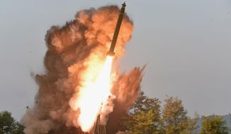 """This Tuesday, Sept. 10, 2019, photo provided by the North Korean government shows a test-firing from a multiple rocket launcher at an undisclosed location in North Korea. KCNA reports North Korean leader Kim Jong-un visited the site. The content of this image is as provided and cannot be independently verified. Korean language watermark on image as provided by source reads: """"KCNA"""" which is the abbreviation for Korean Central News Agency. (Korean Central News Agency/Korea News Service via AP)"""