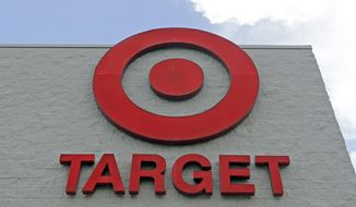 FILE - This June 29, 2016 file photo shows a Target store in Hialeah, Fla.  Target is hiring more than 130,000 people as it ramps up for the critical holiday season, up 8% from last year.  The retailer is doubling the number of seasonal jobs to handle online orders to 8,000.  While the jobs are described as season, Target said Tuesday, Sept. 10, 2019 that 40% of the 120,000 people hired last year stayed with the Minneapolis company after the holidays.  (AP Photo/Alan Diaz, File)