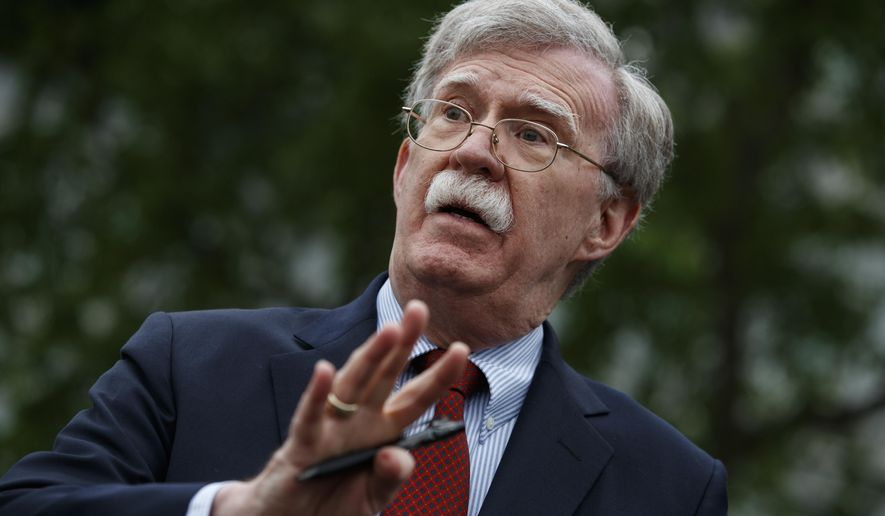 FILE - In this May 1, 2019 file photo, National security adviser John Bolton talks to reporters outside the White House in Washington. Trump says he fired national security adviser John Bolton, says they 'disagreed strongly' on many issues. (AP Photo/Evan Vucci)