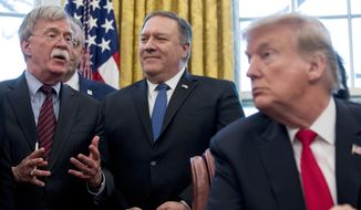 "In this Feb. 7, 2019, file photo, from left, National Security Adviser John Bolton, accompanied by Secretary of State Mike Pompeo, and President Donald Trump, speaks before Trump signs a National Security Presidential Memorandum to launch the ""Women's Global Development and Prosperity"" Initiative in the Oval Office of the White House in Washington. (AP Photo/Andrew Harnik) ** FILE **"