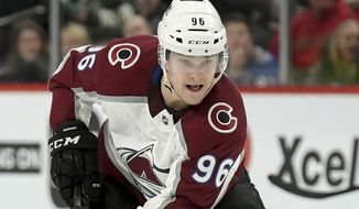 FILE - In this March 19, 2019, file photo, Colorado Avalanche left wing Mikko Rantanen skates against the Minnesota Wild during the second period of an NHL hockey game, in St. Paul, Minn. With NHL training camps set to open this week, roughly a dozen prominent restricted free agents still don't have contracts, including Tampa Bay's Brayden Point, Toronto's Mitch Marner, Boston's Charlie McAvoy and Brandon Carlo and Colorado's Mikko Rantanen. Those absences could hang over their teams for days, weeks or even months and have raised questions about why it's taken so long to get them signed. (AP Photo/Craig Lassig, File)