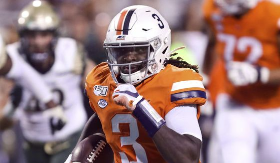 Virginia quarterback Bryce Perkins (3) runs in front of William & Mary defenders during the first half of an NCAA college football game in Charlottesville, Va., Friday, Sept. 6, 2019. (AP Photo/Andrew Shurtleff) **FILE**