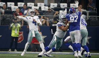 Dallas Cowboys quarterback Dak Prescott (4) throws a pass under pressure from New York Giants defensive tackle Dexter Lawrence (97) during a NFL football game in Arlington, Texas, Sunday, Sept. 8, 2019. (AP Photo/Ron Jenkins) **FILE**