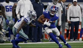 Dallas Cowboys free safety Xavier Woods (25) defends as New York Giants wide receiver Sterling Shepard (87) looks for running room after catching a pass during a NFL football game in Arlington, Texas, Sunday, Sept. 8, 2019. (AP Photo/Michael Ainsworth) ** FILE **