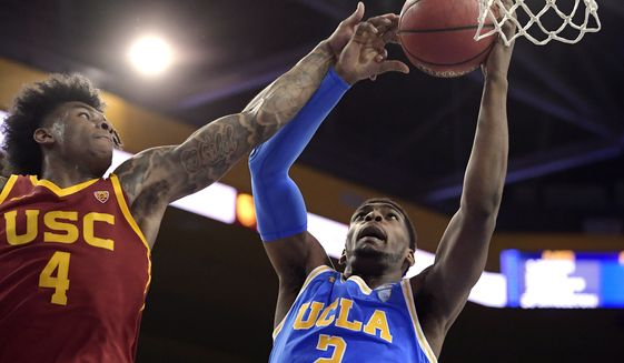 In this Feb. 28, 2019, file photo, UCLA forward Cody Riley, right, grabs a rebound away from Southern California guard Kevin Porter Jr. during the first half of an NCAA college basketball game in Los Angeles. The NCAAs Board of Governors is urging Gov. Gavin Newsom not to sign a California bill that would allow college athletes to receive money for their names, likenesses or images. In a six-paragraph letter to Newsom, the board said the bill would give California schools an unfair recruiting advantage. As a result, the letter says, the NCAA would declare those schools ineligible for its events. (AP Photo/Mark J. Terrill, File) **FILE**