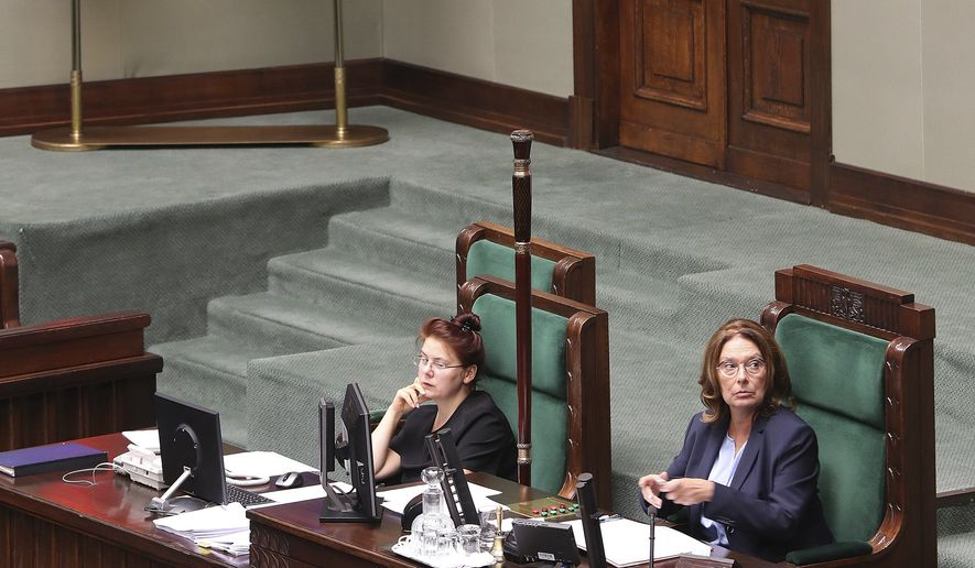 Deputy parliament speaker and the opposition candidate for prime minister in Oct. 13 election, Malgorzata Kidawa-Blonska,right, presides over an almost empty lower house during the last session of parliament before Oct.13 general election, in Warsaw, Poland, Wednesday, Sept. 11, 2019. In an unprecedented move, the ruling party is having the session recess until after the election, raising questions about its intentions..(AP Photo/Czarek Sokolowski)