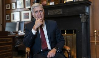 Associate Justice Neil Gorsuch, President Donald Trump's first appointee to the high court, speaks to The Associated Press about events that have influenced his life and the loss of civility in public discourse, in his chambers at the Supreme Court in Washington, Wednesday, Sept. 4, 2019. Gorsuch has written a new book on the importance of civics and civility, and a defense of his preferred originalism method of interpreting laws and the Constitution. (AP Photo/J. Scott Applewhite)