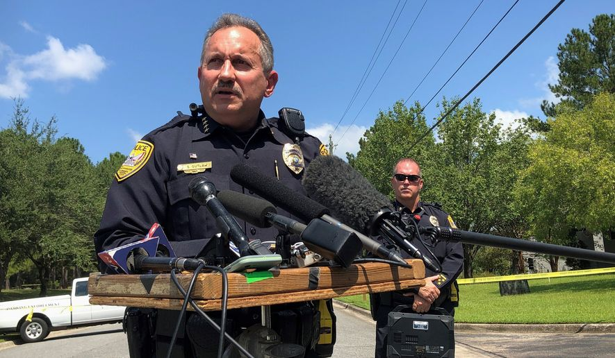 Acting Tallahassee Police Chief Steven Outlaw briefs reporters in Tallahassee, Fla., Wednesday, Sept. 11, 2019, hours after police say a 41-year-old man stabbed five co-workers at a business that supplies doors and windows to residential and commercial customers. (AP Photo/Bobby Caina Calvan)