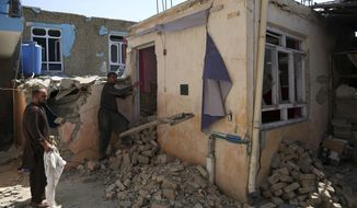 In this Tuesday, Sept. 10, 2019, photo, Afghans inspect their damaged house after a large explosion last week near a compound housing several foreign organizations and guesthouses, in Kabul, Afghanistan. The Taliban car bomb targeted the compound but instead shredded Afghan homes, with stunned and bloodied families picking up children and fleeing in darkness as their once-solid world collapsed. As America on Wednesday mourns thousands of civilians killed in the 9/11 attacks, weary Afghans watch their own toll from the aftermath continue to rise. (AP Photo/Rahmat Gul)