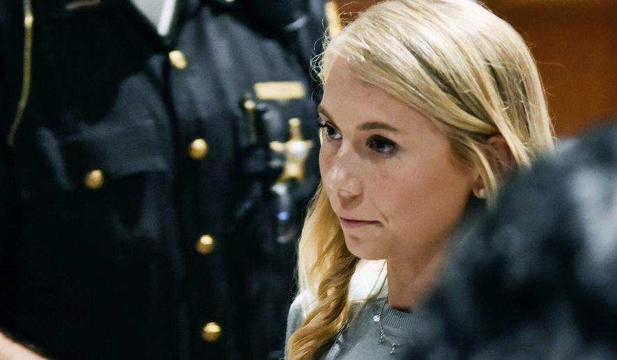 Brooke Skylar Richardson stands during a break in her trial in the Warren County Common Pleas Court Tuesday, Sept. 10, 2019, in Lebanon, Ohio. Richardson is accused of killing and burying her newborn daughter in the backyard of her home. (Nick Graham/The Journal-News via AP, Pool)