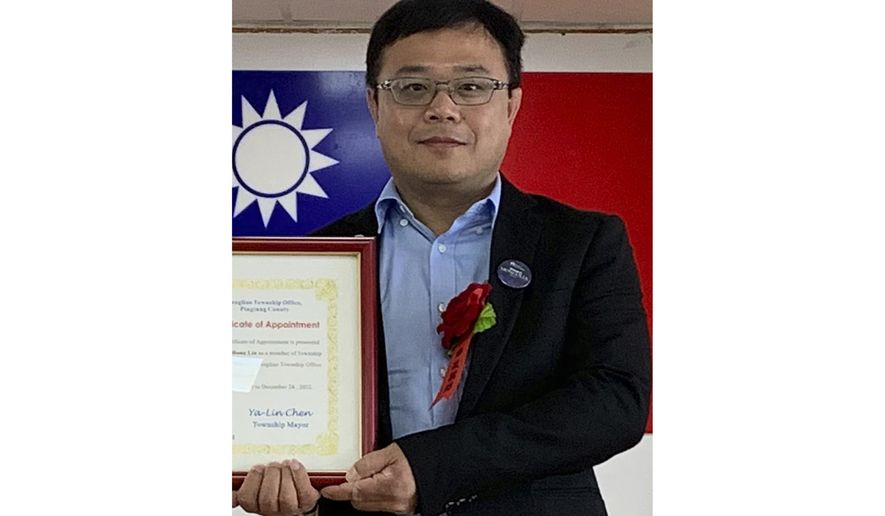 FILE - In this June 20, 2019, file photo released by Pingtung County Fangliao Township Office, Lee Meng-chu accepts a certificate for his adviser role during a ceremony in Pingtung County, Southern Taiwan. China has confirmed it is holding the Taiwanese man who reportedly sent back photos of Chinese paramilitary police massing equipment near the Hong Kong border. The spokesman for China's Taiwan Affairs Office said Wednesday, Sept. 11, 2019 that Lee is under investigation on suspicion of engaging in criminal activity harmful to national security. (Pingtung County Fangliao Township Office via AP, File)
