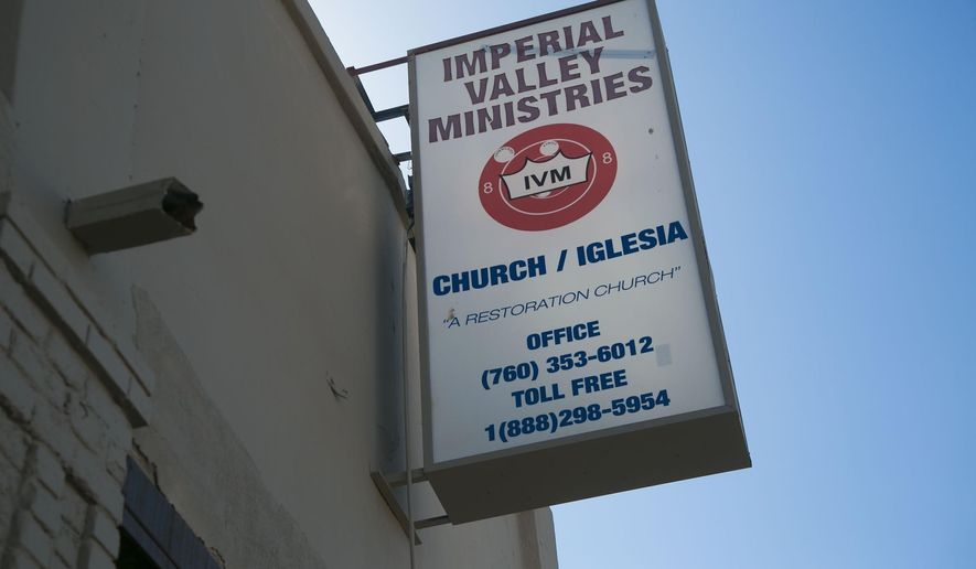 This is the headquarters of the Imperial Valley Ministries located in El Centro, Calif. It is housed in an old movie theater. U.S. Attorney Robert Brewer on Monday, September 10, 2019 announced the arrest of 12 people, leaders of the Imperial Valley Ministries, accusing them of subjecting 31 mostly homeless people to forced labor forcing them to surrender welfare benefits and making them panhandle for the financial benefit of church leaders.  (John Gibbins/The San Diego Union-Tribune via AP)