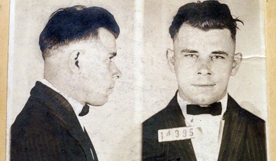 FILE - This file photo shows Indiana Reformatory booking shots of John Dillinger, stored in the state archives. The History Channel has dropped out of a planned documentary on John Dillinger that would have included the exhumation of the 1930s gangster's Indianapolis gravesite. A&E Networks spokesman Dan Silberman says The History Channel is no longer involved in the Dillinger documentary. Silberman says the network won't comment on why it has withdrawn from the project. The planned exhumation of Dillinger's grave is the subject of a lawsuit. (Indiana State Archives/The Indianapolis Star via AP, File)