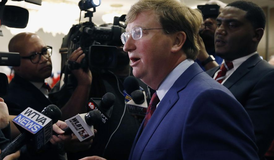 FILE - In this Aug. 27, 2019, file photo, Lt. Gov. Tate Reeves speaks with reporters after being declared winner of the runoff for the Republican nomination for governor in Jackson, Miss. Mississippi Democratic Attorney General Jim Hood released an investigative report Wednesday, Sept. 11, that says his rival in this year's governor's race, Reeves, improperly sought to influence a roadbuilding project near Reeves' neighborhood. (AP Photo/Rogelio V. Solis, File)