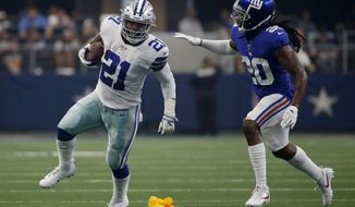 Dallas Cowboys running back Ezekiel Elliott (21) runs the ball as New York Giants cornerback Janoris Jenkins (20) defends in the first half of a NFL football game in Arlington, Texas, Sunday, Sept. 8, 2019. (AP Photo/Ron Jenkins) ** FILE **