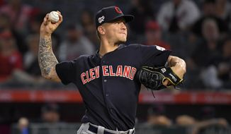 Cleveland Indians starting pitcher Zach Plesac throws during the first inning of the team's baseball game against the Los Angeles Angels on Tuesday, Sept. 10, 2019, in Anaheim, Calif. (AP Photo/Mark J. Terrill)