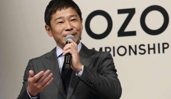 FILE - In this Nov. 20, 2018, file photo, Zozo Chief Executive Yusaku Maezawa speaks during a press conference on the PGA Tour in Tokyo. Yahoo Japan Corp. said Thursday, Sept. 12, 2019 it will put up a tender offer, estimated at 400 billion yen ($3.7 billion), for Zozo Inc., a Japanese online retailer started by a celebrity tycoon. Maezawa is known for lavish spending on artworks by Jean-Michel Basquiat, a Stradivarius violin and a future trip to the moon. (AP Photo/Koji Sasahara, File)